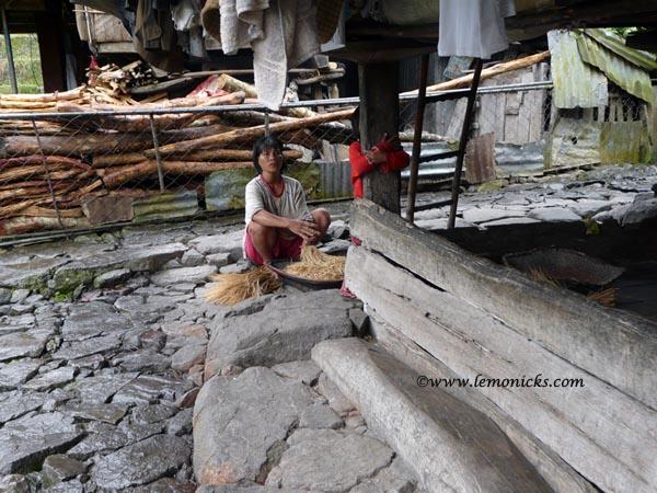 village woman doing chores @lemonicks.com