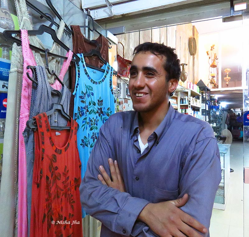 Ayman in his shop and below, with me. He tied the Keffiyeh on my head.
