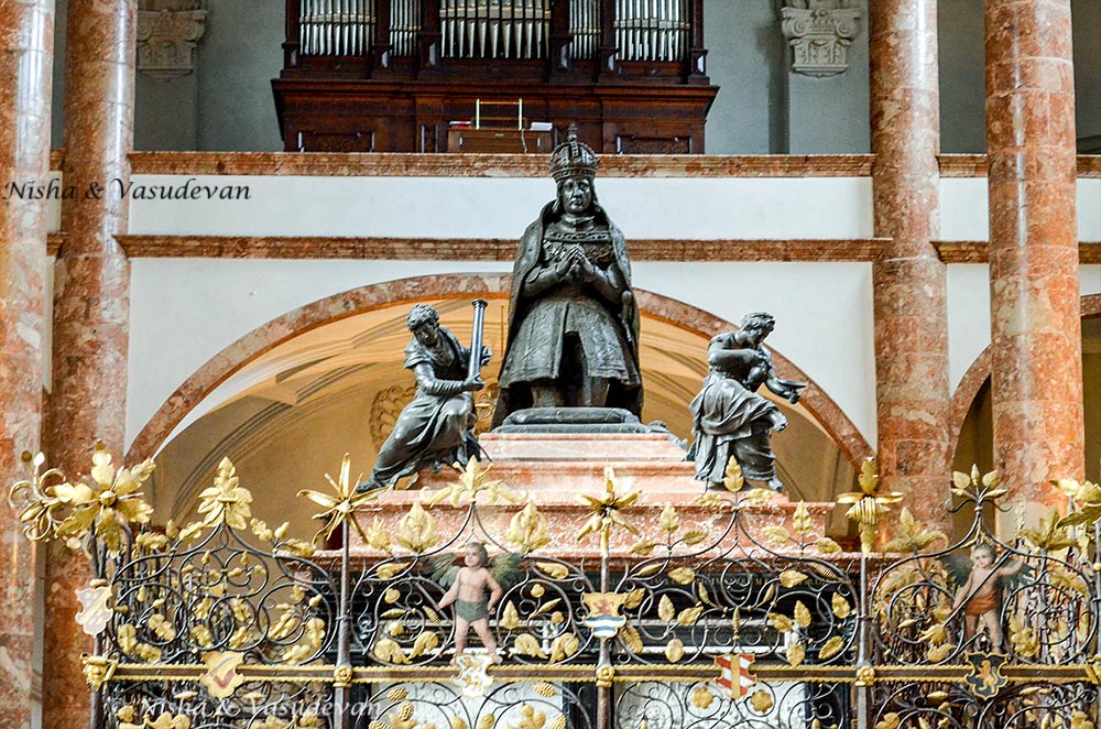 Statue of Maximilian I at his cenotaph, inside the Court Church Innsbruck, Austria. Self guided walking tour of innsbruck